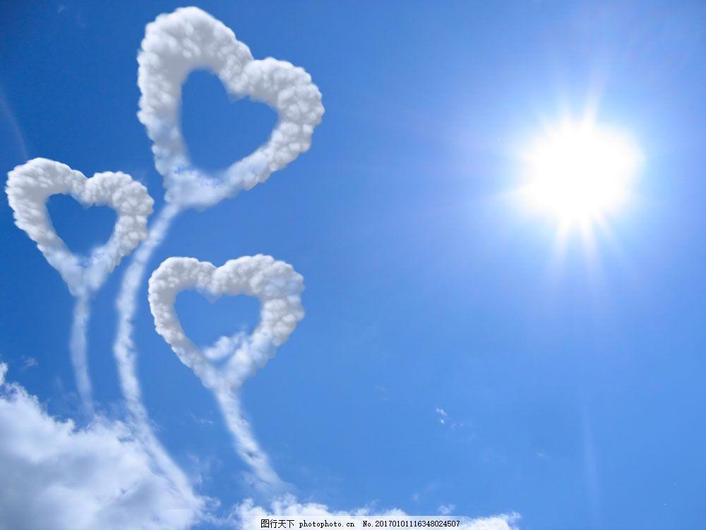 空中的心形白云图片素材 蓝天 天空 太阳 心形白云 天空图片 风景图片
