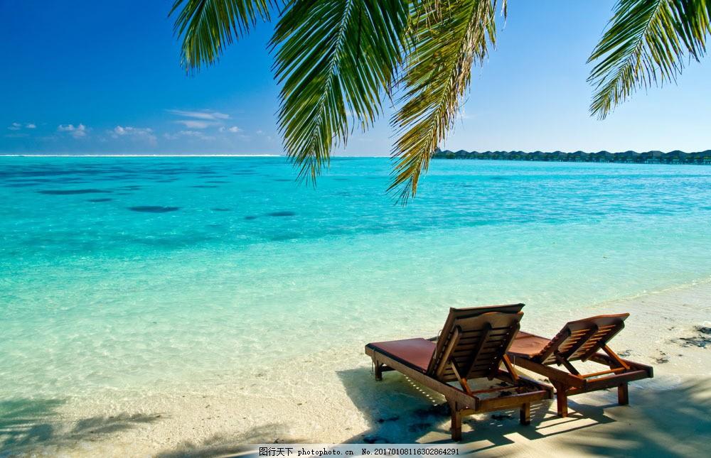 海边的躺椅 海边的躺椅图片素材 海滩 沙滩 椅子 树枝 美景 大海图片图片